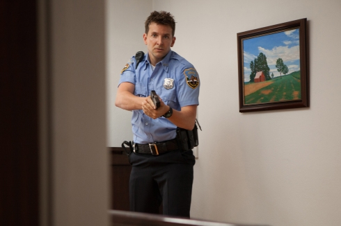 "If I can't give my male readers a pistol brandishing Bradley Cooper doing his best, ""Police! Get On The Ground!"" pose, then I am a terrible film critic."