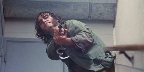 Joaquin Phoenix stares us down in Inherent Vice (image: http://corndogchats.blogspot.com/)