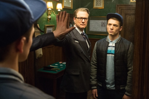 Colin Firth and Taron Egerton share a Matrix moment in Kingsman: The Secret Service. (credit: www.collider.com)