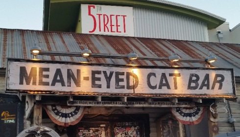 mean-eyed-cat-sign